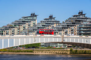 Wandsworth bridge with riverside apartments in the background in London